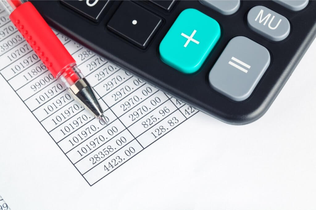 calculator-and-red-pen-PMM7R46